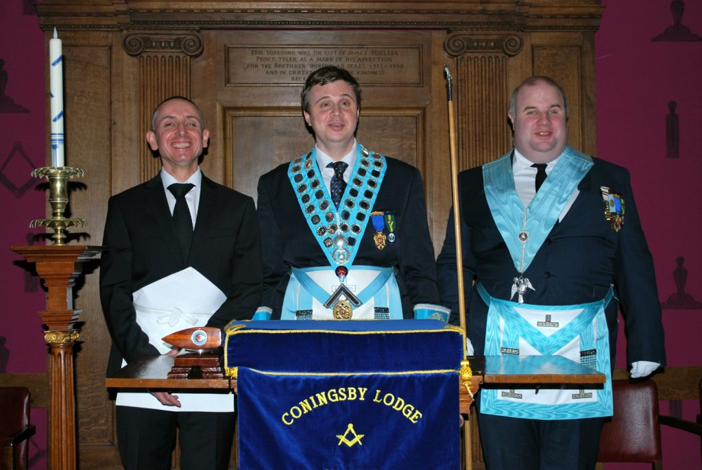 Initiate Jason Payne, Worshipful Master Andy Bailey, and Junior Deacon Basil Clement