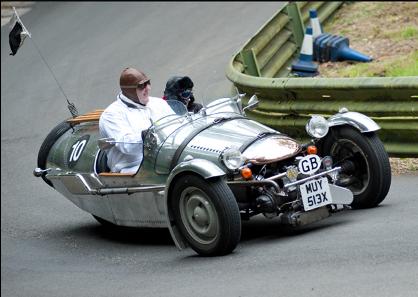 3 wheeled pemberton on the hill climb track going around a corner