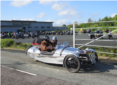 3 wheeled kit car called a Pembleton, silver in colour being driven on road