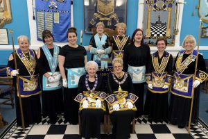 Photo of a group of women Freemasons in their regalia