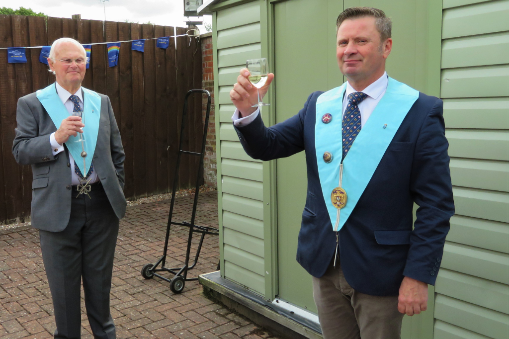 The worshipful master of Royal Edward Lodge raises a toast to the NHS