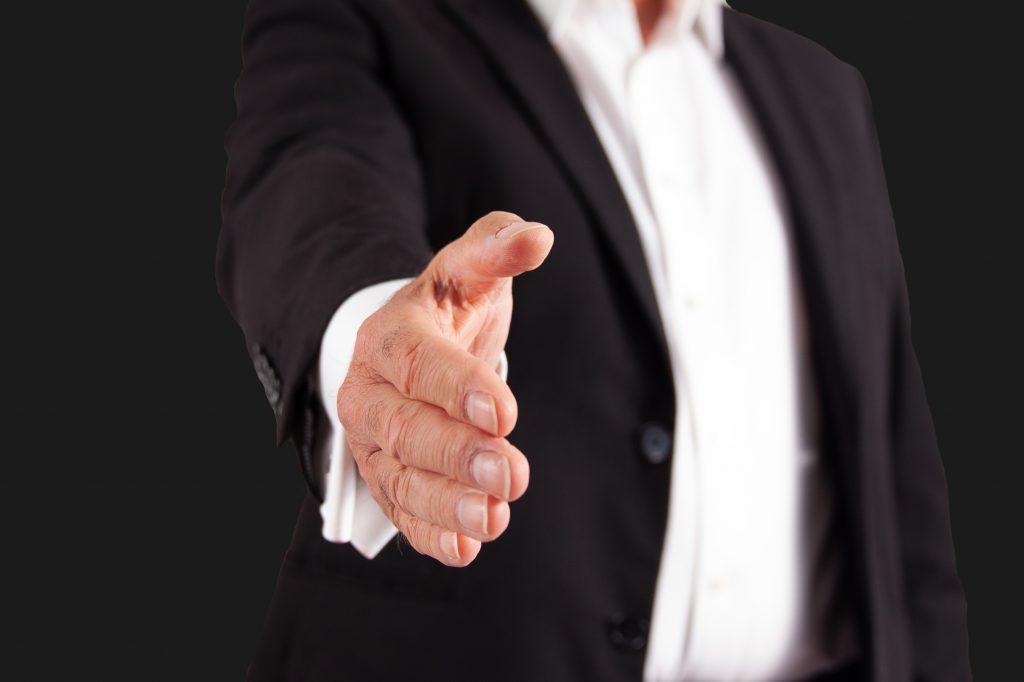 A Mason offering a handshake