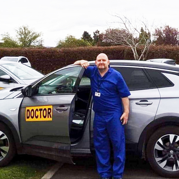 Pete White standing next to his 4x4 with doctors sign on door