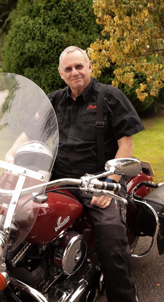 Michael Holland sitting on his Motor Bike